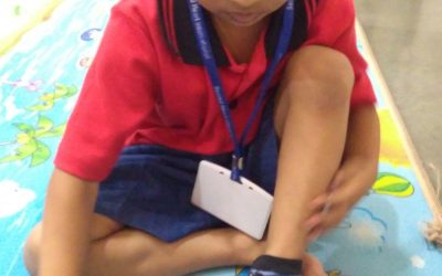 K1 – Life Skills – Learning to wear socks on their own
